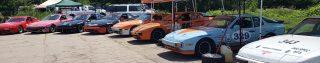 8 944 Spec racecars lined up at the Road Atlanta Paddock