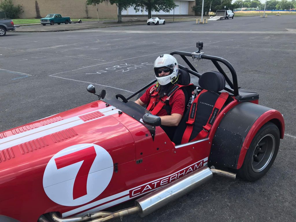 Image of my self after driving the Caterham 7. I'm wearing a huge grin under the helmet.